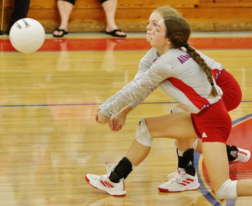 Alba-Golden's backline, Cacie Lennon and Kamrin Wright, moves in for a dig against Cumby last Friday.