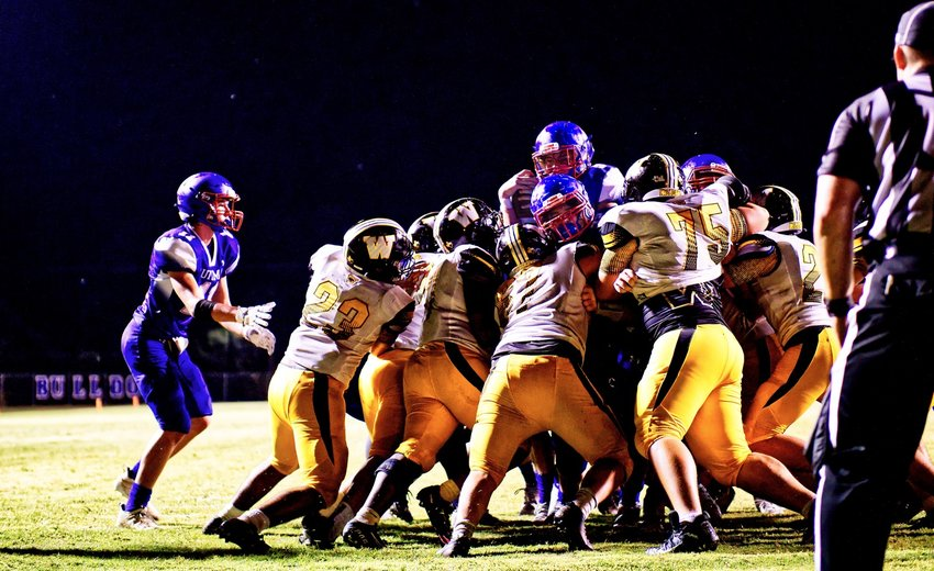 Cameron Crockett goes over the top of the pile to score the winning touchdown in overtime for the Quitman Bulldogs.