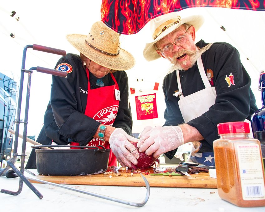 Amelia Taylor and Wes Stigen of Gilmer prepare Argentinian meat.
