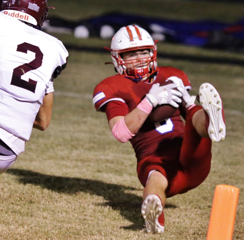 Alba-Golden's Jerry Skinner hauled in a tough catch for a score in the closing moments of the first half against Cooper.