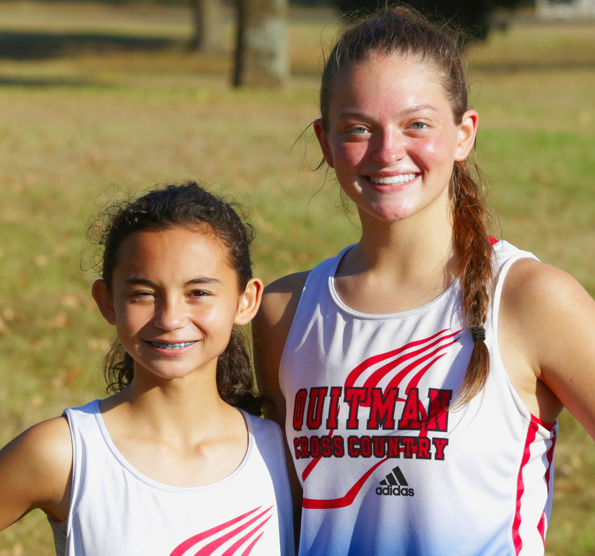 Lady Bulldogs Katie Degorostiza and Madyson Pence, who finished in first and third place respectively, led the Quitman girls to a district cross country championship.