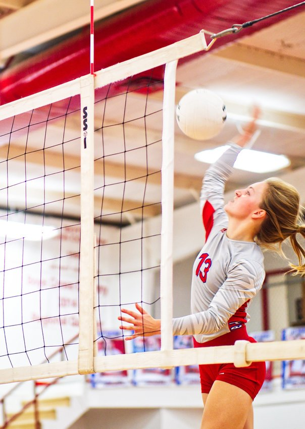 Cacie Lennon goes for a kill shot for the Alba-Golden Lady Panthers in action against Quinlan Boles Tuesday, Oct. 5.